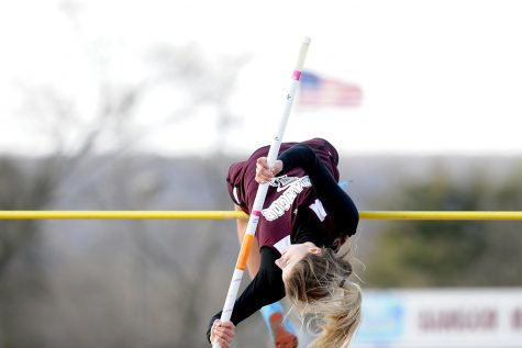 GIRLS TRACK AND FIELD JUMPING TO NEW HEIGHTS