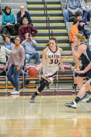 DON'T GIVE UP THE BASE LINE! A Northern Lehigh player gives Maddie Minner a wide open lane along the base line for an easy reverse layup. The sophomore currently has 80 total career points.