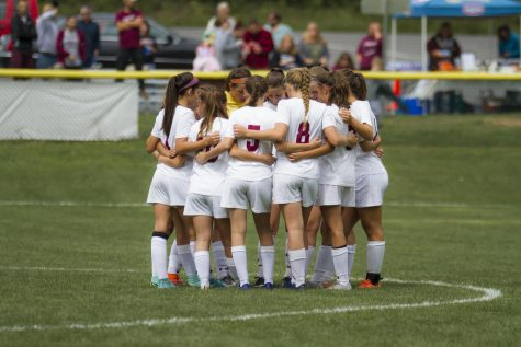 BANGOR BABES UNITE The team huddles up and discusses a game plan. The Slaters won 6-0 Stroudsburg South.
