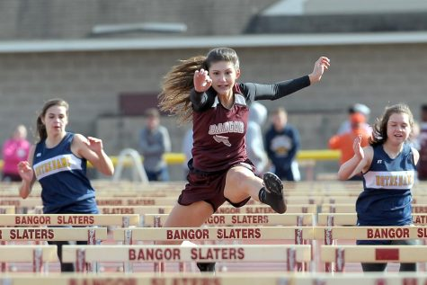 LEAD THE WAY! Junior Elyse Ippolito leads the pack in 100-meter hurdles with excellent form.