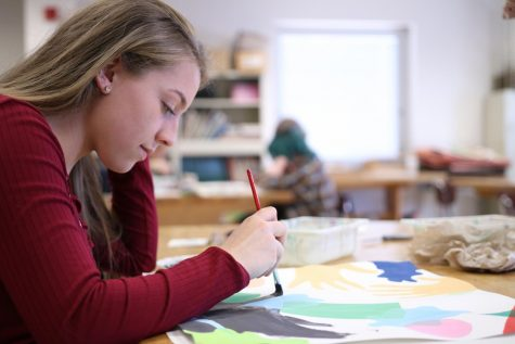 STROKE AWAY! Freshman Taylor brands shows off her amazing painting skills.