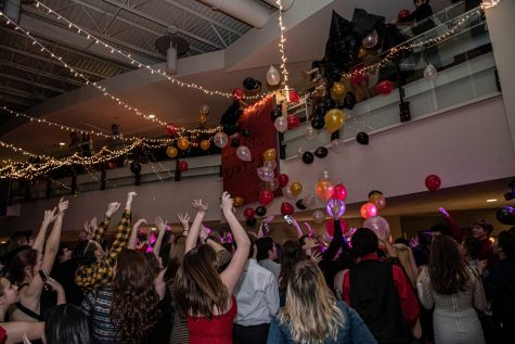 BALLOON FUN. Students of Bangor Area High School put their hands up and get exhilarated for the balloon drop.