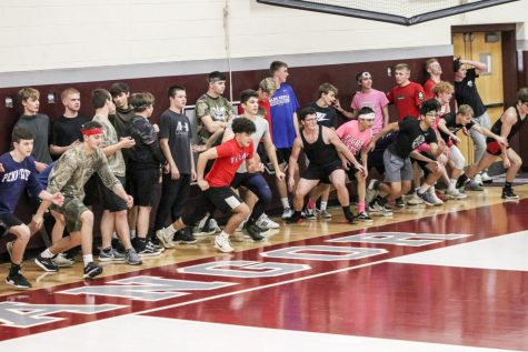 OFF TO THE RACES!-Bangor High School dodgeball students viciously attacks the line in the opening run to start game.