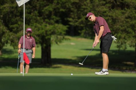 ANYONE UP FOR SOME PUT-PUT?- Sophomore Dylan Hurd expertly delivers the quick backhander in order to hole the ball.