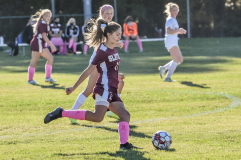KICKIN' IT! Junior Mattie Martin (forward) sends a ball upfield and gains the Slaters major field position. With her aggressive game tactics and sharp footwork, Martin has consistently earned her place in the starting lineup.