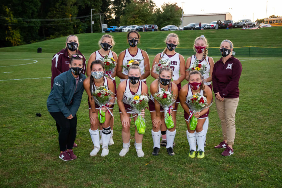 WE LOVE OUR SENIORS! Slater field hockey seniors pose while celebrating an exciting senior night win. Going all out, these fashionable Slaters are even sporting class of 2021 masks!