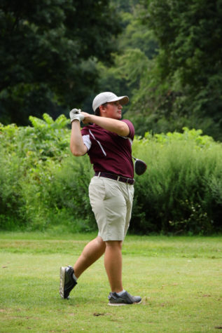 SWINGING FOR THE STARS! Junior Freddy Bacon effortlessly displays his trustworthy drive as he launches the golf ball across the course.  After a regular season full of success, Bacon took his winning swing to the Colonial League Tournament and earned himself sixth place.