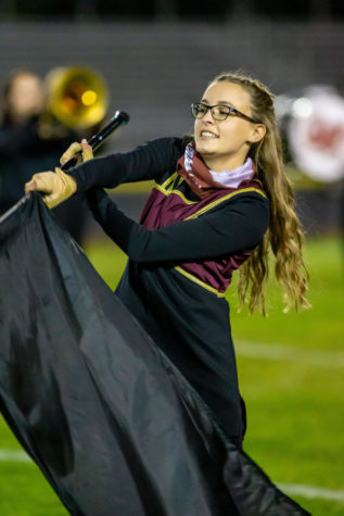 GRAB AND GO! Senior color guard flag master Avalon Sager perfectly executed her flag routine and looks to make a dramatic finish. Sager will turn in her Slater flag and transform into a Falcon next fall as she is committed to Cedar Crest College with a major of surgical nursing.