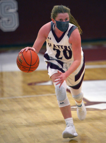 DRIBBLE, DRIBBLE, SHOOT! Senior Emma Stout speed dribbles her way across the court in search of the net. Stout's unwavering dedication and love for the game made her the perfect addition to the starting lineup!